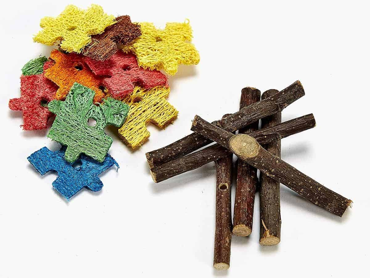 Two piles of wood and puzzle piece hamster chew toys.