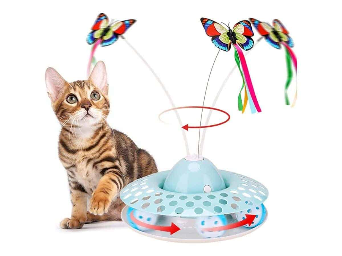 Cat playing with a plastic toy with butterflies and spinning balls.