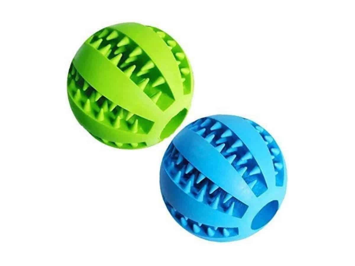 Two dog treat toy balls.