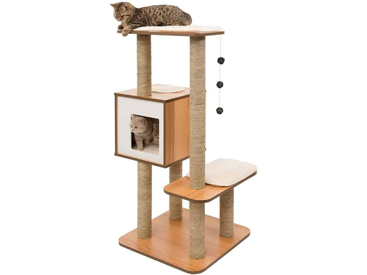 Two cats on a multi-level wooden cat tree.